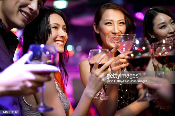 Stylish young people drinking in bar