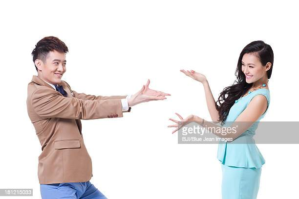 Stylish young woman and man presenting