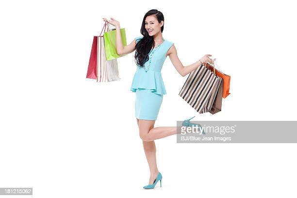 Stylish young woman shopping happily