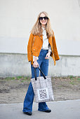 Stylist Alexandra Carl poses wearing an Acne Studios jacket Frame pants and Loewe bag on Day 6 of Paris Fashion Week Womenswear FW15 on March 8 2015...