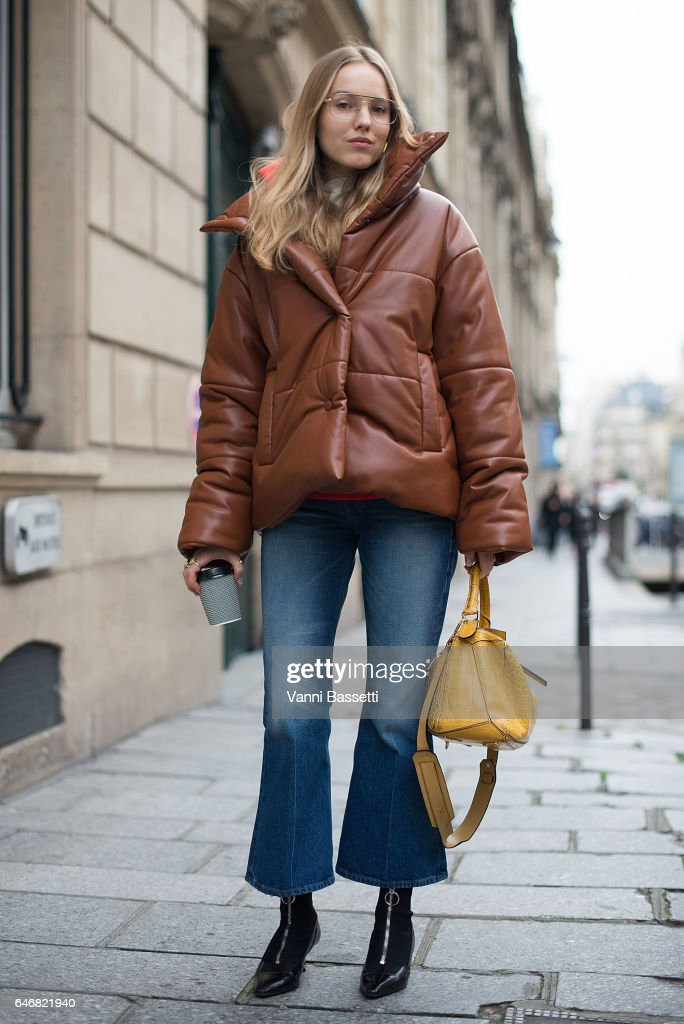 Stylist Alexandra Carl poses with a Loewe bag after the Courreges show during Paris Fashion Week Womenswear FW 17/18 on March 1, 2017 in Paris, France.