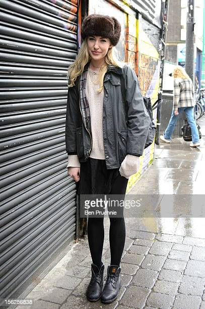 Stylist Alexandra poses wearing a vintage hat Barbour coat Timberland boots American Apparel jumper and a Tiffany and Co necklace on Brick Lane in...