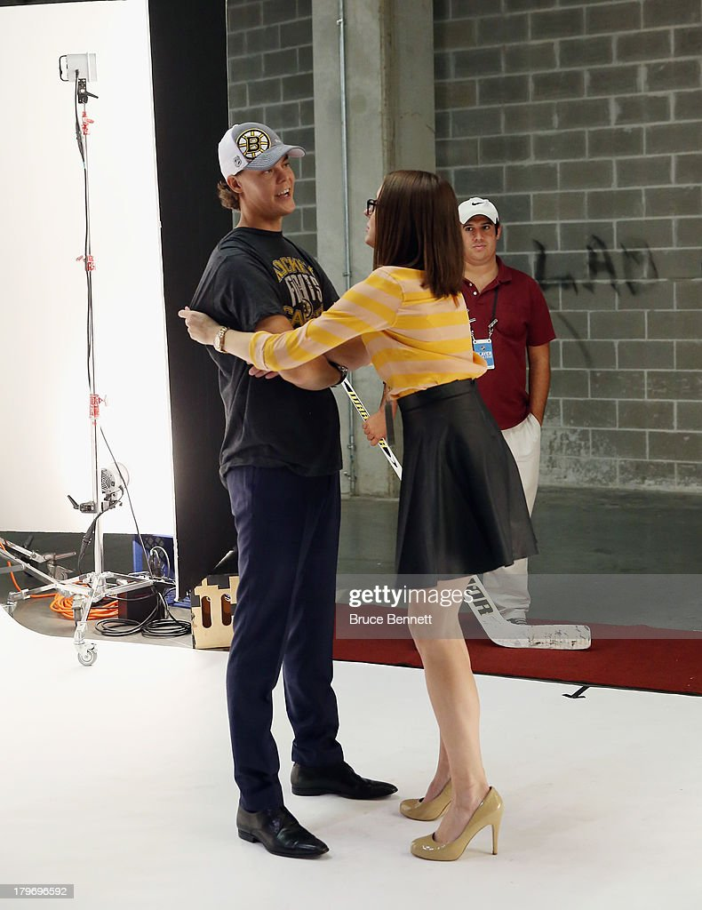 Stylist Amber Janis prepares Tuukka Rask of the Boston Bruins for a portrait session during the National Hockey League Player Media Tour at the Prudential Center on September 6, 2013 in Newark, New Jersey.