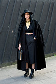 Stylist and Designer Payzee Mahmod wearing Asos trousers La Moda shoes Primark top hat bag and scarf H and M jacket Vintage coat on day 3 of London...