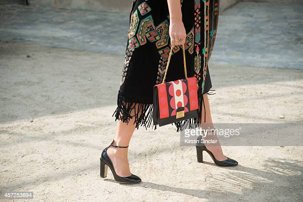 Stylist and Fashion Consultant Kate Foley is wearing a Valentino bag coat and shoes on day 8 of Paris Collections Women on September 30 2014 in Paris...