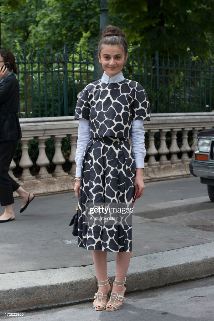 Stylist and fashion editor for Harper's Bazaar Russia Natalia Alaverdian wears an Awake shirt and dress, Dolce and Gabbana bag and Pierre Hardy on day 3 of Paris Collections: Womens Haute Couture on July 03, 2013 in Paris, France.
