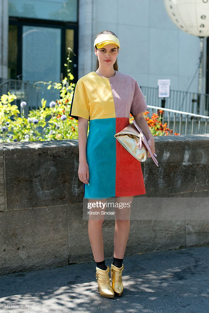 Stylist and Fashion writer Michelle Verpuggi wearing a Photoshop dress and visor, Anna Dello Russo for H and M boots and a Jane Norman bag on day 2 of Paris Collections: Men on June 26, 2014 in Paris, France.