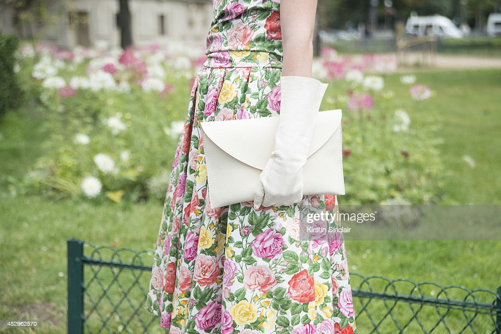 Stylist and Fashion Writer Michelle Verpuggi wearing an Yves Saint Laurent dress, vintage clutch bag and gloves day 3 of Paris Haute Couture Fashion Week Autumn/Winter 2014, on July 8, 2014 in Paris, France.