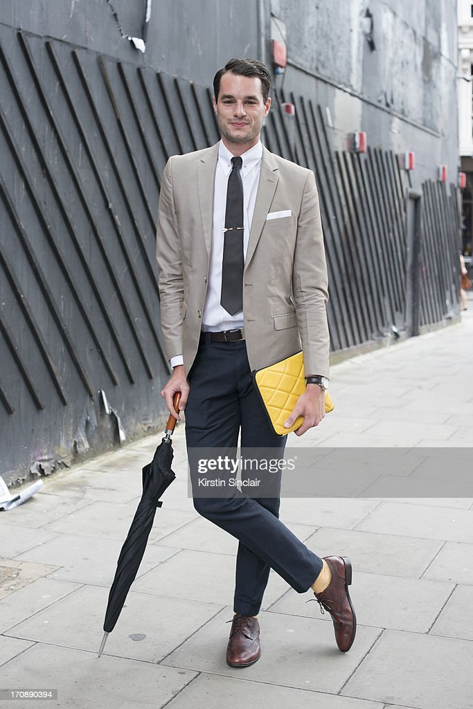 Stylist and presenter Stephen Kelly wears Pied de Terre shoes, Prada trousers, Saville Row shirt, Zara jacket, Oswald Boetang tie, H by Harris bag, vintage pin and tie bar on day 1 of London Collections: Men on June 16, 2013 in London, England.
