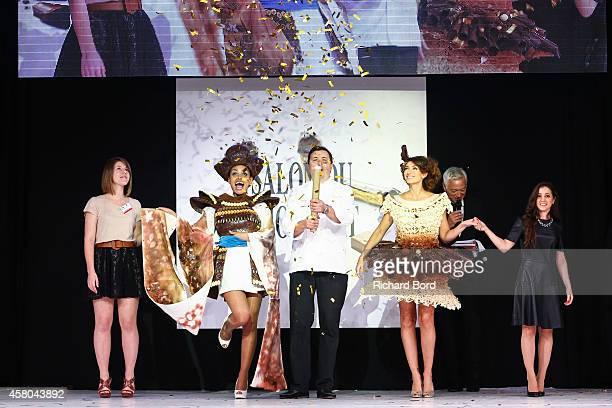 Stylist Audrey Lempeseur Laurence Roustandjee chocolate maker Frederic Cassel Rachel LegrainTrapani and stylist Lauren Bitar walk the runway during...