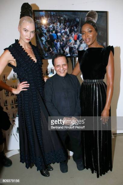 Stylist Azzedine Alaia poses with Karlie Kloss and Naomi Campbell after the Azzedine Alaia Fashion Show as part of Haute Couture Paris Fashion Week...