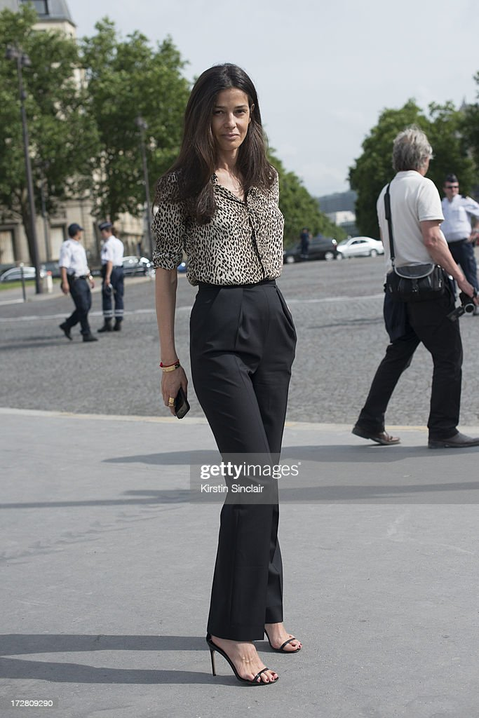 Stylist Barbara Martelo wears Manolo Blahnik shoes, Saint Laurent shirt and Balenciaga trousers sighting on day 1 of Paris Collections: Womens Haute Couture on July 01, 2013 in Paris, France.