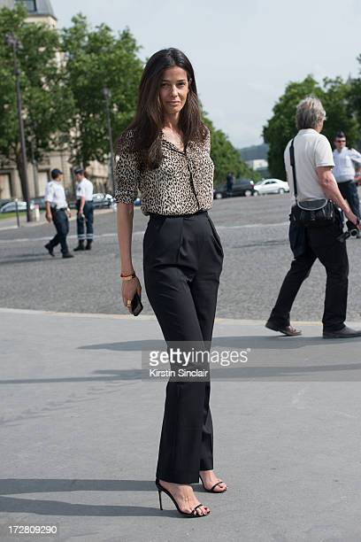 Stylist Barbara Martelo wears Manolo Blahnik shoes Saint Laurent shirt and Balenciaga trousers sighting on day 1 of Paris Collections Womens Haute...