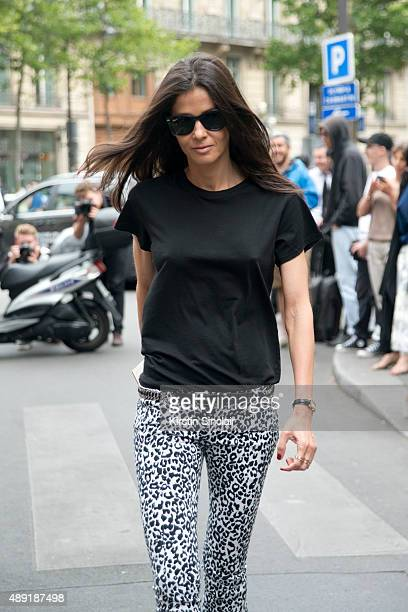 Stylist Barbara Martelo wears vintage Balmain jeans and Ray ban sunglasses on day 4 of Paris Fashion Week Haute Couture Autumn/Winter 2015 on July 8...