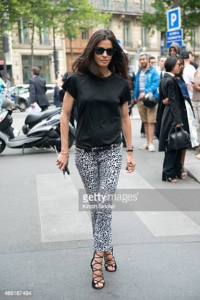 Stylist Barbara Martelo wears vintage Balmain jeans Ray ban sunglasses and Alaia shoes on day 4 of Paris Fashion Week Haute Couture Autumn/Winter...