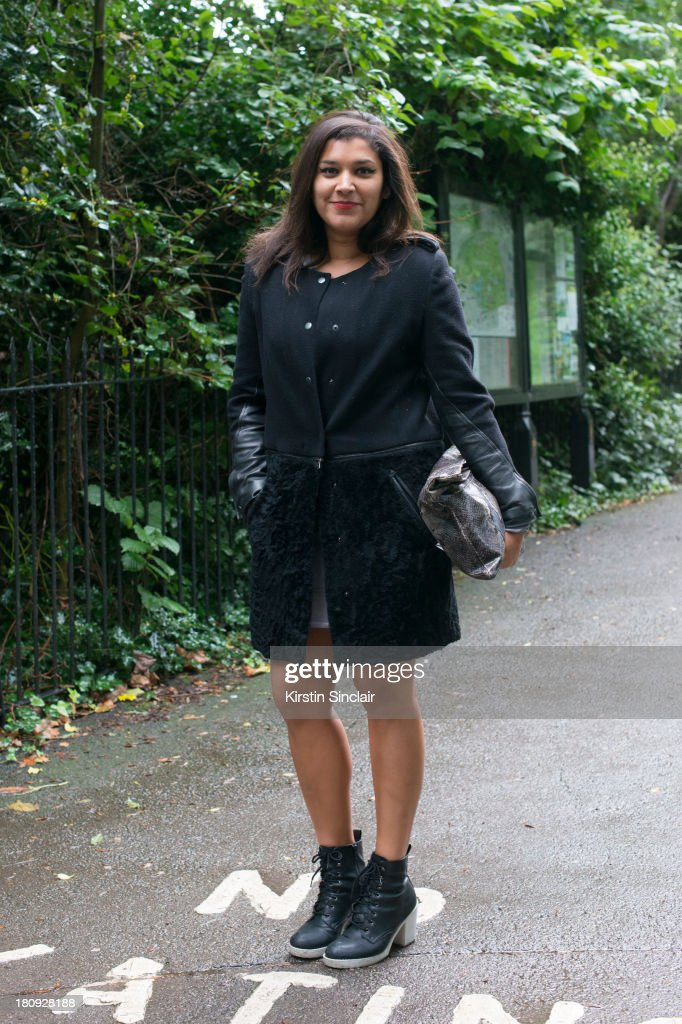 Stylist Bonnie Rakhit wears New Look shoes, vintage bag and a Rag and Bone jacket on day 5 of London Fashion Week Spring/Summer 2013, at Somerset House on September 17, 2013 in London, England.
