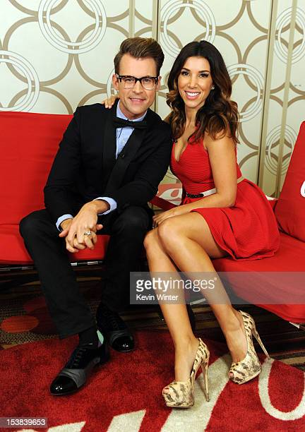 Stylist Brad Goreski and TV personality Adrianna Costa pose during the 40th Anniversary American Music Awards nominations press conference at the JW...