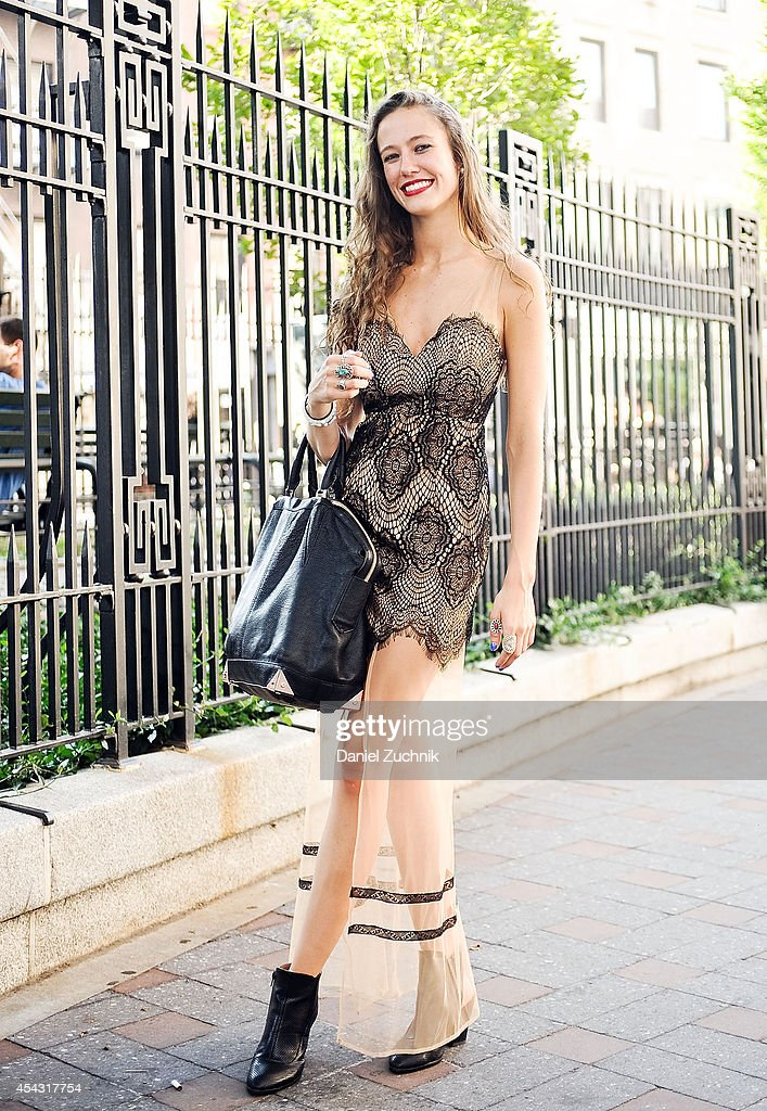 Stylist Brittany Riley is seen around Soho wearing a For Love and Lemons dress, Alexander Wang bag and Tobey boots on August 28, 2014 in New York City.