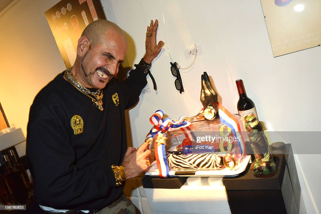 DJ /stylist Claude Sabbah poses with his work during 'Oh! My Gode' Act 2 Exhibition Preview Cocktail Hosted by G Spirits at Galerie Hubert Konrad on November 20, 2012 in Paris, France.