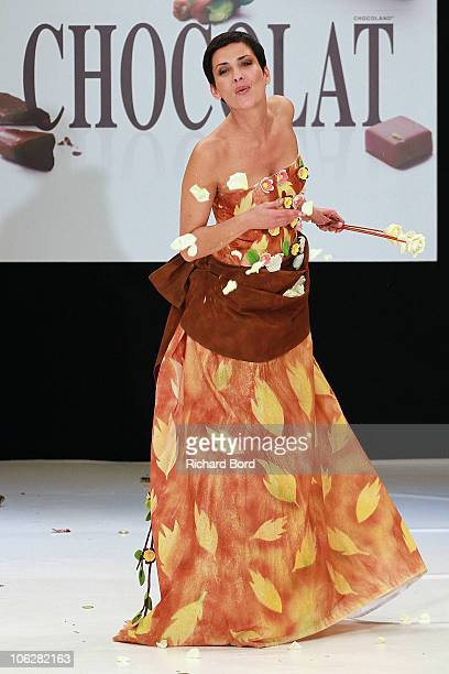 Stylist Cristina Cordula dressed by Arnaud Vodounou for Taillevent and Jasmin Santanen walks the runway at the Salon Du Chocolat 2010 Opening Night...