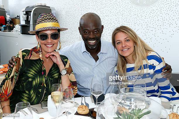 Stylist Cristina Cordula Journalists Sylvere Henry Cisse and Carine Galli attend the 2015 Roland Garros French Tennis Open Day Eleven on June 3 2015...