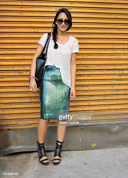 Stylist Debbie Gonzalez seen outside the Gen Art show wearing an HM skirt Reformation shirt Timo Weiland shoes Dolce and Gabbana sunglasses