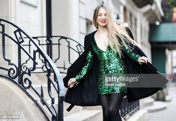 Stylist Elineya is seen on the streets of Manhattan wearing a Balmain x HM wool coat and a Balmain x HM sequin embroidered dress on November 16 2015...