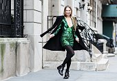 Stylist Elineya is seen on the streets of Manhattan wearing a Balmain x HM wool coat Balmain x HM sequin embroidered dress and Balenciaga boots on...