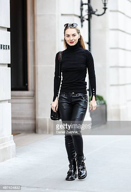 Stylist Elineya is seen on the streets of Manhattan wearing Balmain x HM leather biker pants Zara sweater Rebecca Minkoff bag Balenciaga boots and...