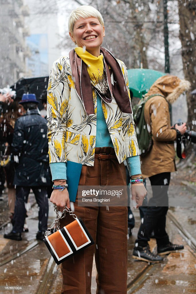 Stylist Elisa Nalin wearing Ventilo sweater and scarf, Tory Burch jacket, Marni trousers and Sigerson Morrison shoes, attends the Milan Fashion Week Womenswear Fall/Winter 2013/14 on February 25, 2013 in Milan, Italy.