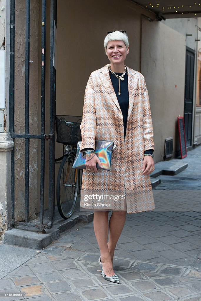 Stylist Elisa Nalin wears a Dries Van Noten jacket and shoes, and other stories clutch bag, Suno NYC skirt, her dads sweater on day 3 of Paris Collections: Men on June 28, 2013 in Paris, France.