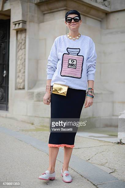 Stylist Elisa Nalin wears a Michaela Burger sweater Sonia Rykiel skirt and bag and Santoni shoes after the Chanel show at the Grand Palais on March 4...