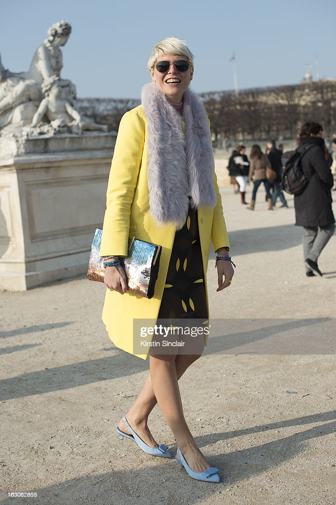 Stylist Elisa Nalin wears Marni jacket and dress, Ventillo scarf, Roger Vivier bag Bruno Magli shoes and War by Parker sunglasses on day 4 of Paris Womens Fashion Week Autumn/Winter 2013 on March 03, 2013 in Paris, France.