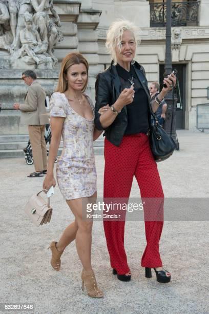 Stylist Elizabeth Sulcer wears a Bvlgari bag with Photographer Ellen Von Unwerth day 2 of Paris Haute Couture Fashion Week Autumn/Winter 2017 on July...