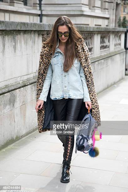 Stylist Estelle Pigault wears Forever 21 coat Fendi accessories Valentino boots New Look sunglasses and Zara jacket on day 3 of London Collections...
