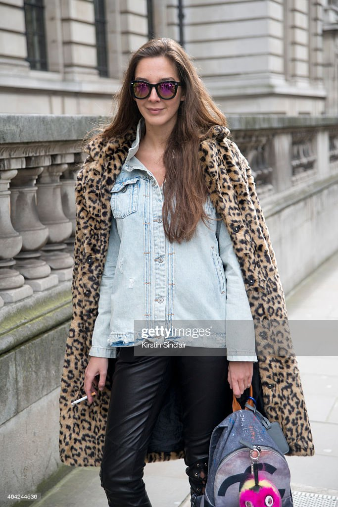 Stylist Estelle Pigault wears Forever 21 coat Fendi accessories New Look sunglasses and Zara jacket on day 3 of London Collections Women on February...