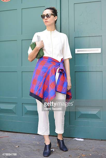 Stylist Francesca Cefis poses wearing an OAMC jacket Prada clutch and Celine shoes before the Y3 show at the Lycee Carnot on June 28 2015 in Paris...