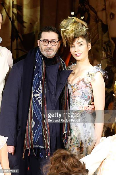 Stylist Franck Sorbier and Supportof the Collection actress Alix Benezech acknowledge the applause of the audience at the end of the Franck Sorbier...