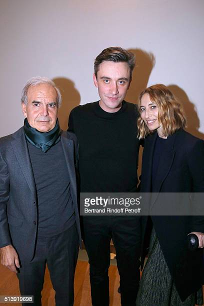 Stylist Guillaume Henry pose Backstage between Alexandra Golovanoff and CEO of Puig Fashion Division and President of the French Federation of...