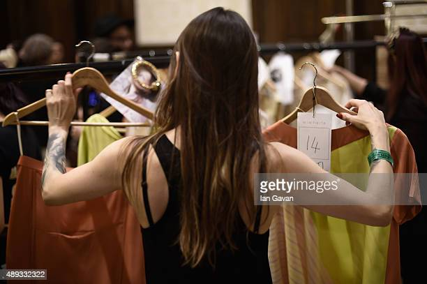 A stylist is seen backstage ahead of the Mimpikita show at Fashion Scout during London Fashion Week Spring/Summer 2016 on September 20 2015 in London...