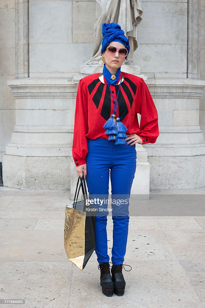 Stylist Isobel Felmer wears and other stories shoes, H and M trousers, Louis Ferand shirt, vintage sunglasses and a hat she made herself on day 1 of Paris Collections: Men on June 26, 2013 in Paris, France.