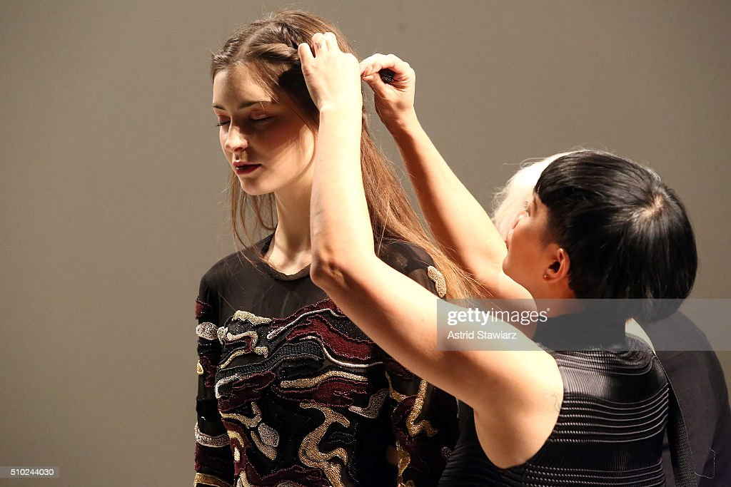 Stylist <a gi-track='captionPersonalityLinkClicked' href=/galleries/search?phrase=Jeanie+Syfu&family=editorial&specificpeople=5710957 ng-click='$event.stopPropagation()'>Jeanie Syfu</a> prepares a model for the runway with hair by TRESemme at the Rachel Zoe A/W16 Presentation during New York Fashion Week: The Shows at The Space, Skylight at Clarkson Sq on February 14, 2016 in New York City.