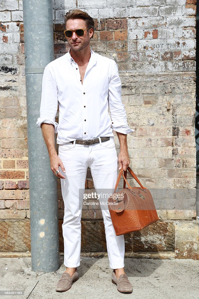 Stylist Jeff Lack wearing Persol sunglasses, vintage bag, Acme pants, Brad Wilson shirt and Aquila shoes at Mercedes-Benz Fashion Week Australia 2014 at Carriageworks on April 9, 2014 in Sydney, Australia.