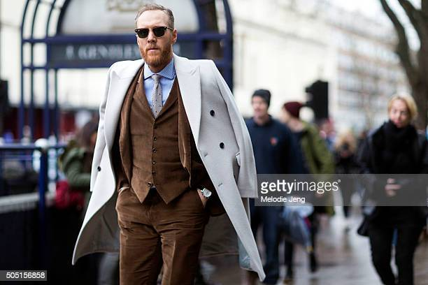 Stylist Joe Ottaway wears a RayBan sunglasses a white Reiss peacoat over the shoulders Massimo Dutti madetomeasure bespoke suit waistcoat and...
