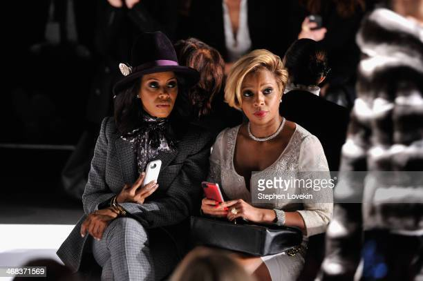 Stylist June Ambrose and musician Mary J Blige attend the Dennis Basso fashion show during MercedesBenz Fashion Week Fall 2014 at The Theatre at...