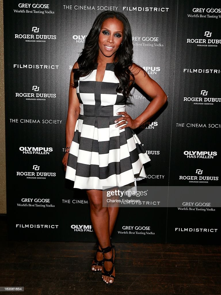 Stylist June Ambrose attends The Cinema Society with Roger Dubuis and Grey Goose screening of FilmDistrict's 'Olympus Has Fallen' at the Tribeca Grand Screening Room on March 11, 2013 in New York City.