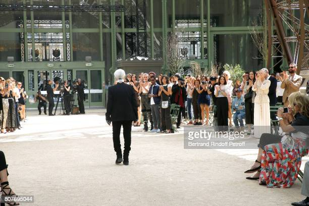 Stylist Karl Lagerfeld acknowledges the applause of Cara Delevingne Aziz Ansari Alessandra Mastronardi Tilda Swinton her husband Sandro Kopp and all...