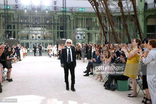 Stylist Karl Lagerfeld acknowledges the applause of the audience at the end of the Chanel Haute Couture Fall/Winter 20172018 show as part of Haute...