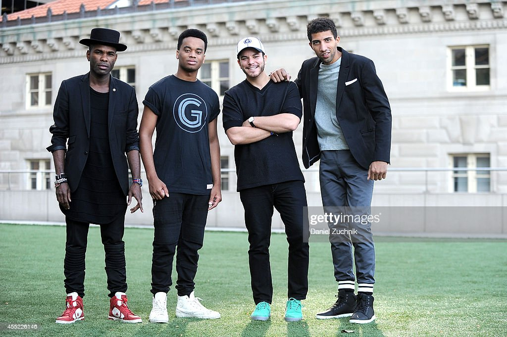 Stylist Keino Benjamin, musician Patrick Toussaint (wearing a Grungy Gentleman x Mitchell & Ness t-shirt), designer Jace Lipstein (wearing a Grungy Gentleman x Mitchell & Ness hat), and actor Rafael Valentino (wearing Grungy Gentleman pants and gray long-sleeve t-shirt) pose for a photo in lower Manhattan on September 10, 2014 in New York City during Mercedes-Benz Fashion Week Spring 2015.