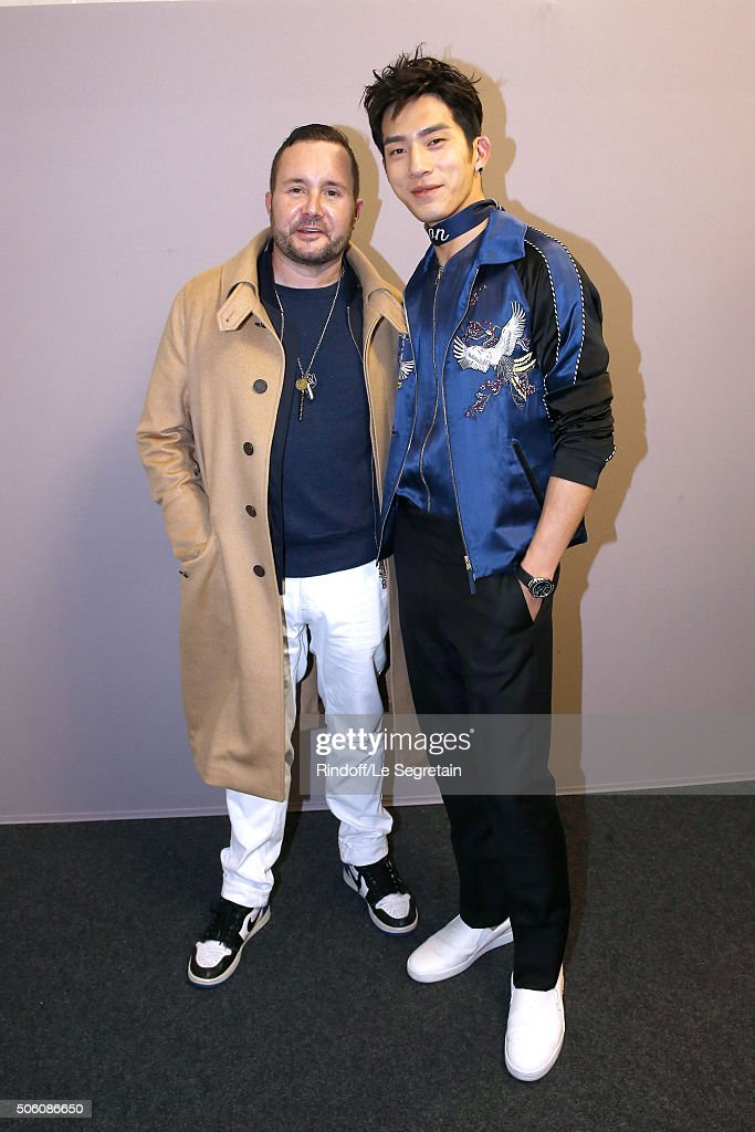 Stylist Kim Jones and Actor and Chinese Singer and Actor Jing Bo Ran pose Backstage after the Louis Vuitton Menswear Fall/Winter 2016-2017 Fashion Show as part of Paris Fashion Week. Held at 'Parc Andre Citroen' on January 21, 2016 in Paris, France.